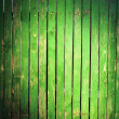 Stock Photo: Green picket fence with light spot