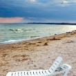 Stock Photo: Chaise lounge on sebeach
