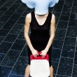 Cloudy girl with a bag — Stock Photo