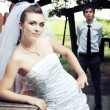 Bride with out of focus groom — Stock Photo
