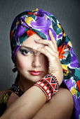 Beautiful young woman in ethnic clothes — Stock Photo