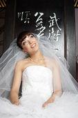 Smiling bride in white dress — Foto de Stock