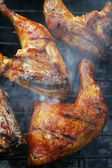 Crisp chicken legs on grill — Stock Photo
