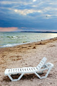 Chaise lounge on sea beach — Stock Photo