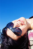Happy teasing girl in sunglasses — Stock Photo