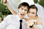 Bride and groom with funny expression — Stock Photo