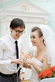 Laughing bride and groom in registry office — Stock Photo