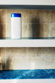 Shampoo bottle on shelf — Stock Photo