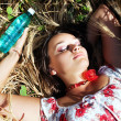 Beautiful girl lying with water botlle — Stock Photo