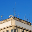 Top of a building with antennas and blank billboards — Stock Photo #1551851