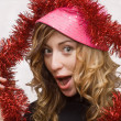 Girl with pink hat and red tinsel — Stock Photo #1553163