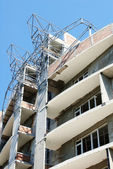 Residential building site with tower crane and blue sky — Stock Photo
