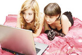Blonde and brunette looking in laptop — Stock Photo