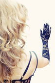 Blonde looking at hand in lace glove — Stock Photo