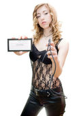 Blonde with slave time card and whip — Stock Photo