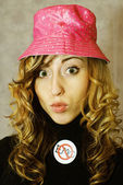Blonde emo girl with pink hat — Stock Photo