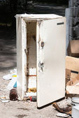 Fridge on the dump — Stock Photo