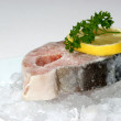 Stock Photo: Salmon fillet on crushed ice with lemon
