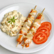 Potato salad with salmon shashlik — Stock Photo