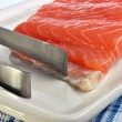 Stock Photo: Salmon fillet and tongs