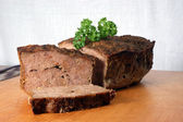 Baked meat loaf with organic parsley — Stock Photo