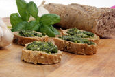 Baguette with fresh pesto — Stock Photo