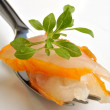 Smoked salmon on a fork — Stock Photo
