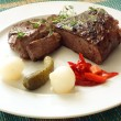 Grilled rump steak with sour vegetable — Stock Photo