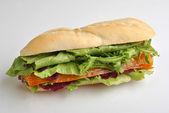 Bread roll with organic smoked salmon — Stock Photo