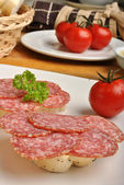 Slice poppy seed bread with salami — Stock Photo