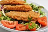 Breaded fish steak with organic herbs — Stock Photo