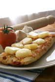 Stone oven backed pizza with pineapple — Stock Photo