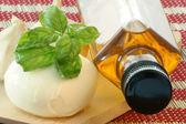 Delicious mozzarella with fresh basil — Stock Photo