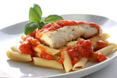 Cooked cod loins tomato sauce — Stock Photo