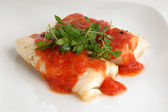 Cooked cod loins with tomato sauce — Stock Photo