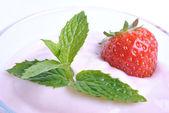 Organic strawberry in yogurt and mint — Stock Photo