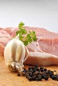 Some raw organic pork chop — Stock Photo