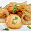 Stock Photo: Roasted potato with onion