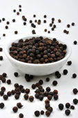 Whole organic black pepper — Stock Photo