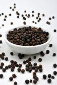 Whole organic black pepper — Stock Photo