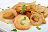 Roasted potato with onion — Stock Photo