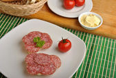 Poppy seed bread with salami — Stock Photo