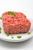 Minced meat with parsley on a plate — Stock Photo