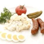 Potato salad and sausage — Stock Photo