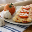 Home made italian pizza with salami - Stock Photo