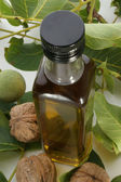 Bottle with walnut oil — Stock Photo
