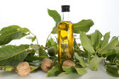 Walnut oil in a bottle — Stock Photo