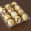 Twelve organic quail eggs - Stock Photo