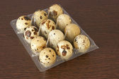 Twelve organic quail eggs — Stock Photo