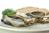 Some sprats and bread — Stock Photo